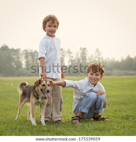 Happy children on walk with dog in park, smile, outdoor