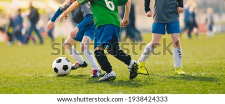 Happy Children Playing Football League. Boys in Soccer Academy Compete in Tournament Game on a Summer Sunny Day. Kids Kicking European Football Match