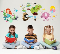Happy children reading books on grey background