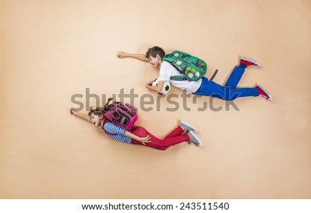 happy children running to...
