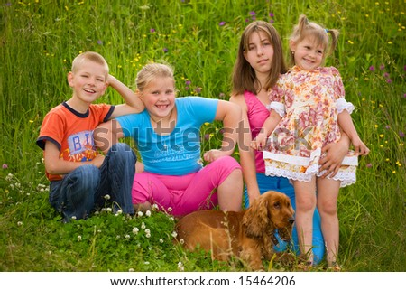 Happy children sit next a dog - stock photo