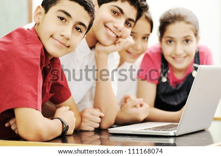 Happy children smiling and laughing in the classroom #111168074