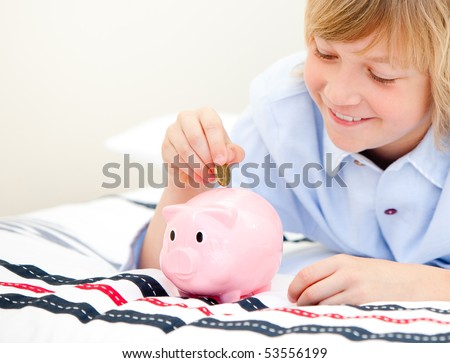 Happy children using a piggy bank at home