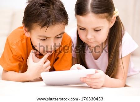Happy children using tablet computer