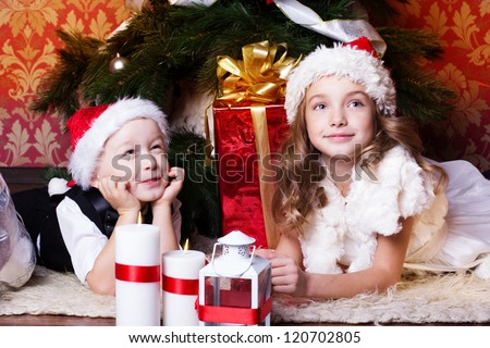 happy children with christmas presents near the fur-tree