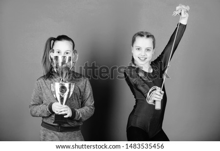 Happy children with gold champion cup. victory of teen girls. Winners in competition. Acrobatics and gymnastics. Little girls hold jump rope. Sport success. they are new champions. I am the champion.