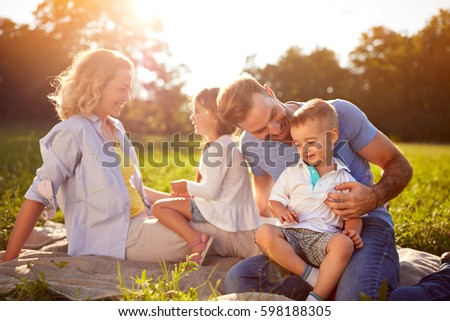 Happy children with parents in nature