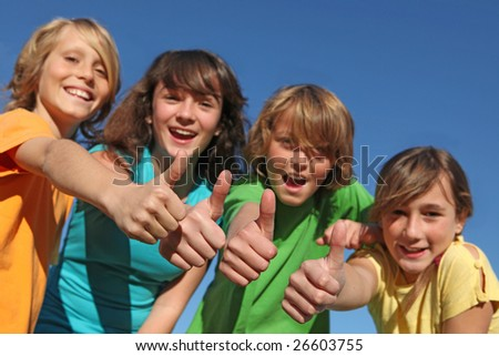 happy children with thumbs up