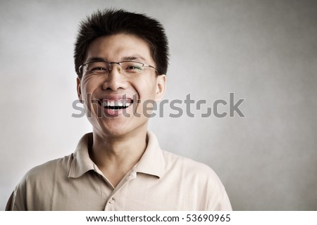 Happy Chinese man, series from several expression with vignetting and color hue in post processing