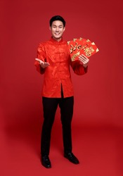 Happy Chinese new year. Asian man holding angpao or red packet This word means