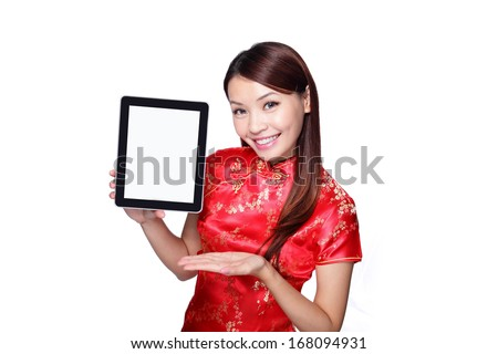happy Chinese new year. beautiful young Asian woman holding tablet pc with empty screen