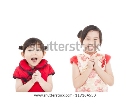 happy chinese new year. two asian girls with Congratulation gesture