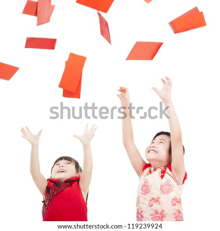 happy chinese new year.two asian kids trying to catch red envelope for good luck and rich