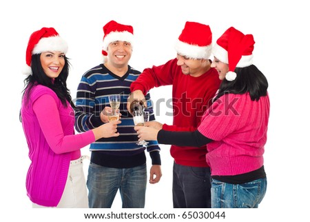 Happy Christmas friends pouring champagne in glasses to tasting together isolated on white background