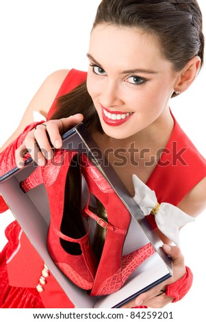 Happy Christmas girl holding box with red shoes