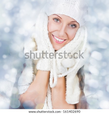 Happy Christmas girl wearing white knitted hat and gloves