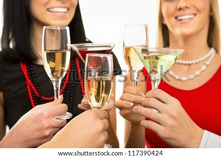 Happy Christmas. Image of people hands with crystal glasses full of champagne