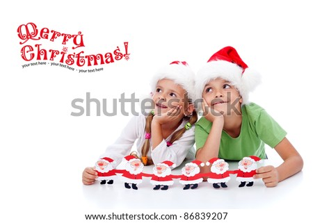 Happy christmas kids dreaming about santa - looking to copy space