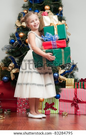 Happy Christmas -  little girl with Christmas gifts