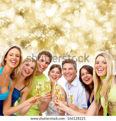 Happy Christmas people group drinking champagne. New year party.