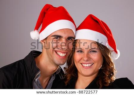 Happy christmas young couple, studio shot.