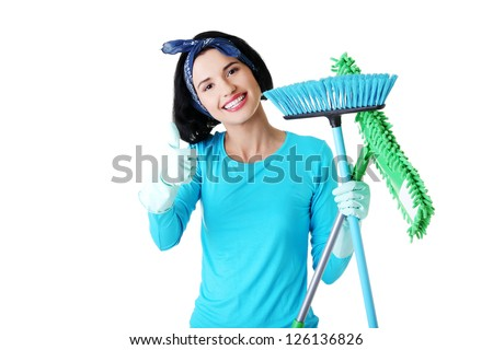 Happy cleaning woman gesturing thumbs up, isolated on white