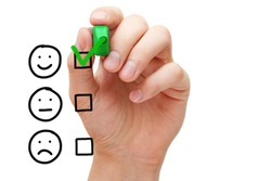 Happy client putting check mark with green marker on customer service evaluation form.