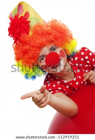 happy clown pointing on something