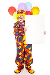 Happy clown points to blank sign, ready for text.  Full body isolated on white.