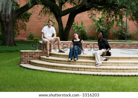 happy college students hanging out on campus