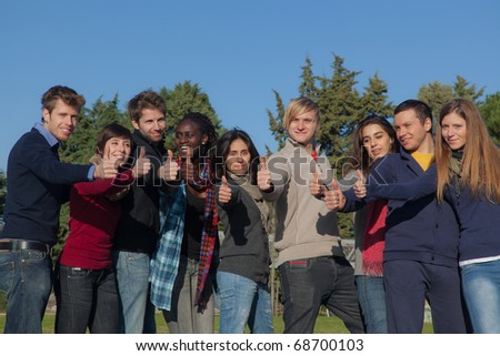 Happy College Students with Thumbs Up