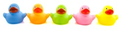 Happy colorful rubber ducks in a row isolated over white