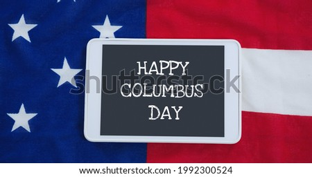 Happy columbus day text on digital tablet against american flag in background. columbus day template background design concept