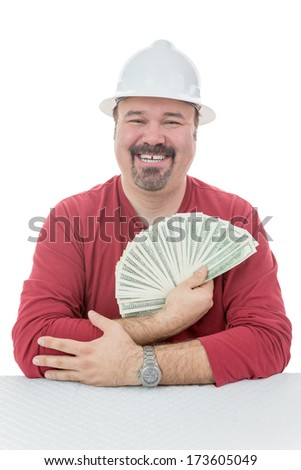 Happy construction worker wearing a hard-hat holding a large amount dollar bills