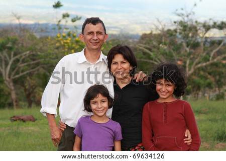 Happy Costa Rican family of four