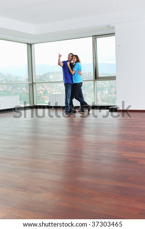 happy couple at big bright comfort apartment celebrate with glasses of champagne
