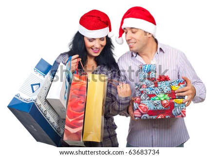 Happy couple at shopping for Christmas  looking in bags and  being satisfied of what they bought isolated on white background