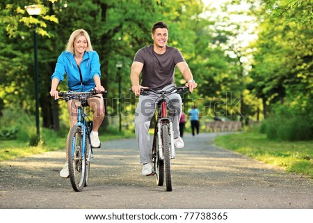 Happy couple biking in the city park, Skopje, Macedonia