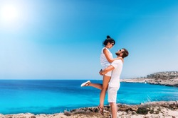 Happy couple by the sea. Man and woman having fun on the sea. Honeymoon lovers. Man and woman on the island. Couple in love on vacation. Sea tour. Honeymoon trip. Couple in love at the blue lagoon