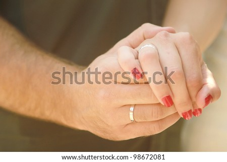 Happy couple  Close-up photo of a caucasian couple's hands on their wedding day.