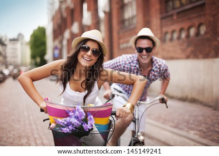 Happy couple cycling in the city #145149241