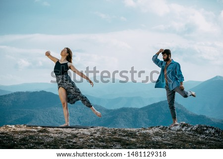 Happy couple dancing together outdoors. Caucasian man and Caucasian woman enjoying a quality time together #1481129318