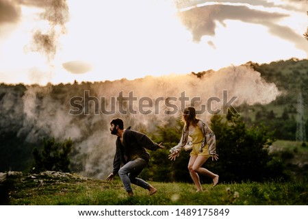 Happy couple dancing together outdoors. Caucasian man and caucasian woman enjoying a quality time together #1489175849