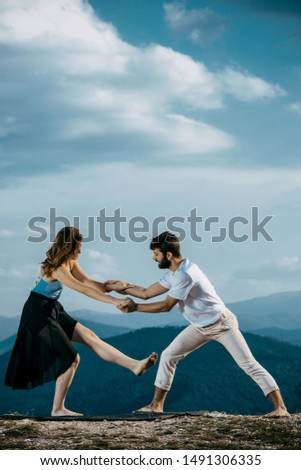 Happy couple dancing together outdoors. Caucasian man and caucasian woman enjoying a quality time together