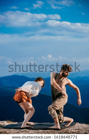 Happy couple dancing together outdoors. Caucasian man and Caucasian woman enjoying a quality time together, copy space