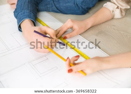 Happy couple drawing plan of their flat  #369658322