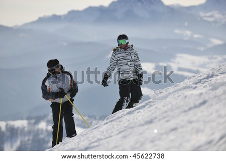 happy couple driving and relaxing with snowboard and ski at winter season on mountain