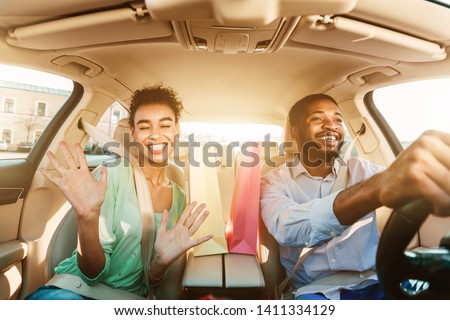 Happy Couple Driving Home After Shopping In Mall, Listening Music And Singing In Car