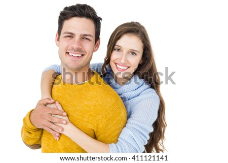 Happy couple embracing and looking camera on white background #411121141
