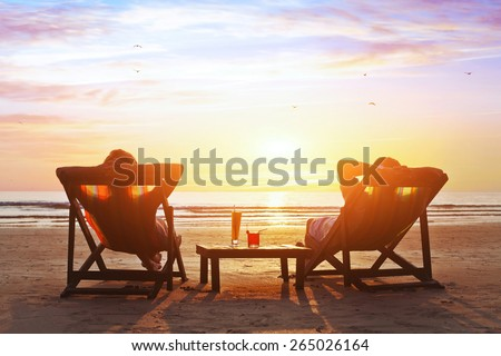 happy couple enjoy luxury sunset on the beach during summer vacations #265026164